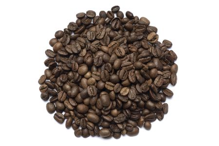 Coffee beans spilled onto a white background. Closeup of whole beans isolated on white. Stock Photo - 1268291