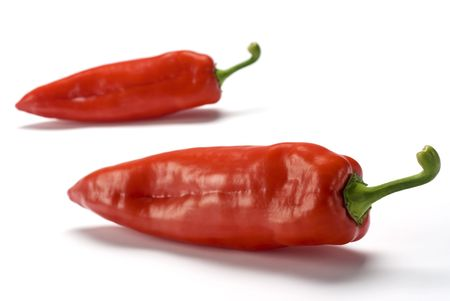 Two red peppers over white background Stock Photo - 2995174