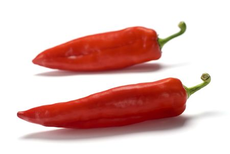 Two Red sweet peppers over white background Stock Photo - 2995134