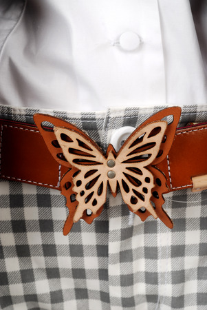 Detail of modern woman belt with butterfly detail application   Stock Photo