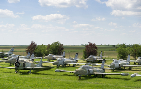 Old military fighter jets in the field Editorial