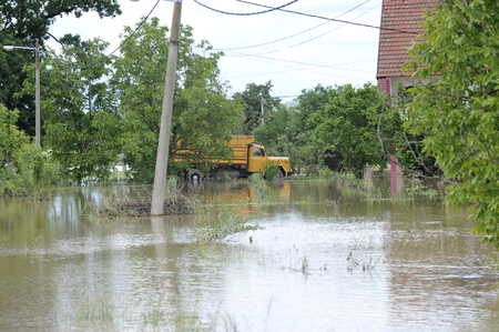 The consequences of flooding, flooded house with truck