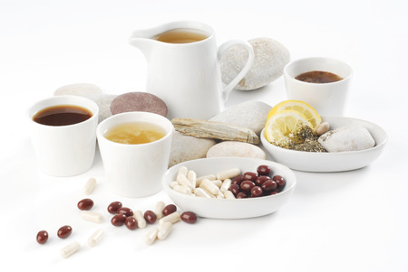 Diet pills with arrangement of coffee and tea cups