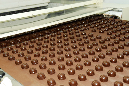 Production of chocolates, factory conveyor