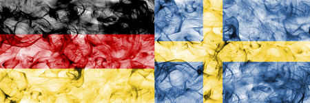 Germany vs Sweden smoke flag Stock Photo