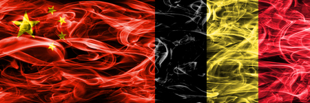 China vs Belgium smoke flags placed side by side Stock Photo