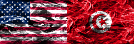 United States vs Tunisia smoke flags concept placed side by side