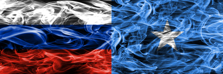 Russia vs Somalia smoke flags placed side by side Banque d'images