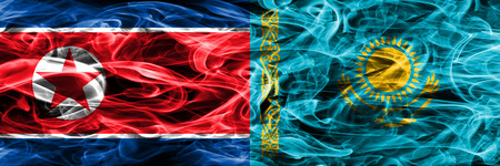 North Korea vs Kazakhstan smoke flags placed side by side