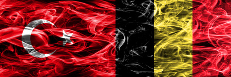 Turkey vs Belgium smoke flags placed side by side. Turkish and Belgium flag together Stock Photo