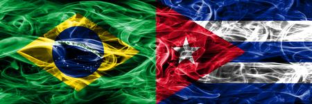 Brazil vs Cuba smoke flags placed side by side 版權商用圖片