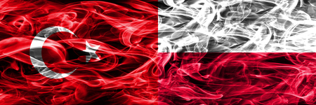 Turkey vs Poland smoke flags placed side by side. Turkish and Poland flag together 版權商用圖片