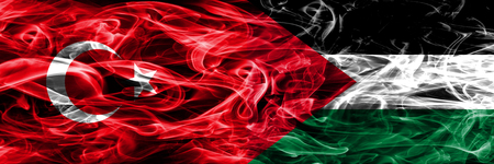 Turkey vs Palestine smoke flags placed side by side. Turkish and Palestine flag together Stockfoto