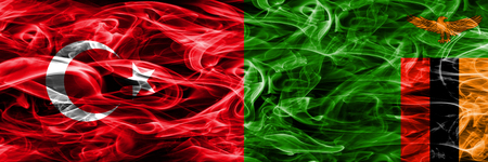 Turkey vs Zambia smoke flags placed side by side. Turkish and Zambia flag together Stock Photo