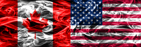 Canada vs US smoke flags placed side by side. Canadian and US flag together 스톡 콘텐츠