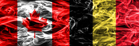 Canada vs Belgium smoke flags placed side by side. Canadian and Belgium flag together Stock Photo