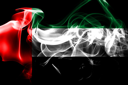National flag of United Arab Emirates made from colored smoke isolated on black background