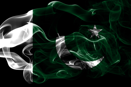 National flag of Pakistan made from colored smoke isolated on black background. Abstract silky wave background. Imagens