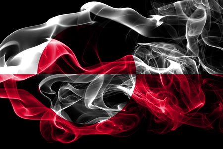 National flag of Greenland made from colored smoke isolated on black background. Abstract silky wave background.