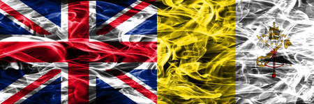 United Kingdom vs Vatican city smoke flags placed side by side. Thick colored silky smoke flags of Great Britain and Vatican city 스톡 콘텐츠