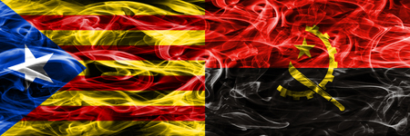 Catalonia vs Angola copy smoke flags placed side by side. Thick colored silky smoke flags of Catalan and Angola copy