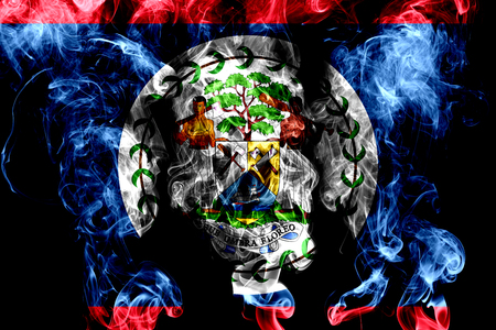National flag of Belize made from colored smoke isolated on black background