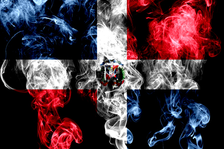 National flag of Dominican Republic made from colored smoke isolated on black background