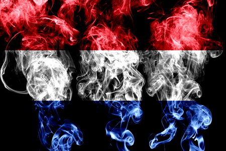 National flag of Netherlands made from colored smoke isolated on black background