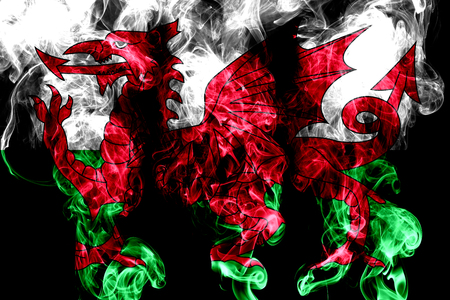 National flag of Wales made from colored smoke isolated on black background