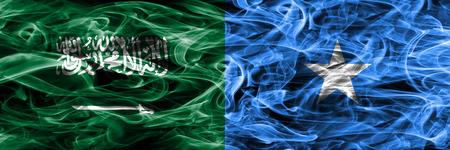 Saudi Arabia vs Somalia smoke flags placed side by side. Thick colored silky smoke flags of Saudi Arabia and Somalia