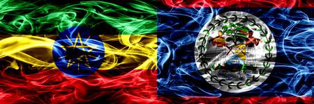 Etiopía vs Belice, Belice banderas de humo coloridas colocadas una al lado de la otra Foto de archivo