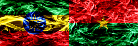 Ethiopia vs Burkina Faso colorful smoke flags placed side by side