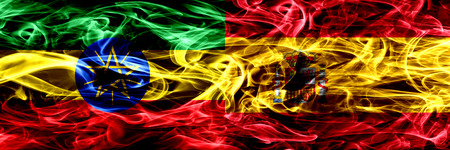 Ethiopia vs Spain, Spanish colorful smoke flags placed side by side Foto de archivo