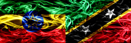 Ethiopia vs Saint Kitts and Nevis colorful smoke flags placed side by side Foto de archivo