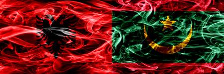 Albania vs Mauritania, Mauritanian smoke flags placed side by side. Thick colored silky smoke flags of Albanian and Mauritania, Mauritanian