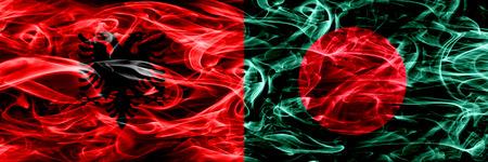 Albania vs Bangladesh, Bangladeshi smoke flags placed side by side. Thick colored silky smoke flags of Albanian and Bangladesh, Bangladeshi Stock Photo