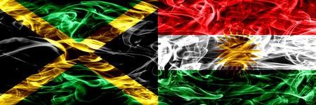 Jamaica vs Kurdistan, Kurdish smoke flags placed side by side. Thick colored silky smoke flags of Jamaican and Kurdistan, Kurdish