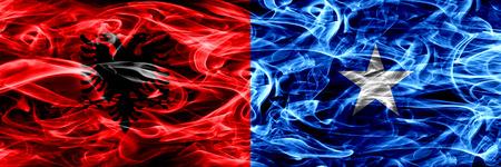 Albania vs Somalia, Somalian smoke flags placed side by side. Thick colored silky smoke flags of Albanian and Somalia, Somalian Banque d'images