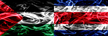 Palestine vs Costa Rica smoke flags placed side by side. Thick colored silky smoke flags of Palestinian and Costa Rica