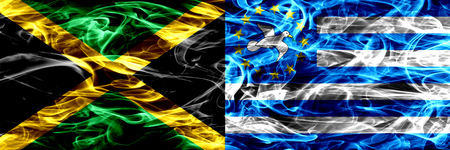 Jamaica vs South Cameroon smoke flags placed side by side. Thick colored silky smoke flags of Jamaican and South Cameroon