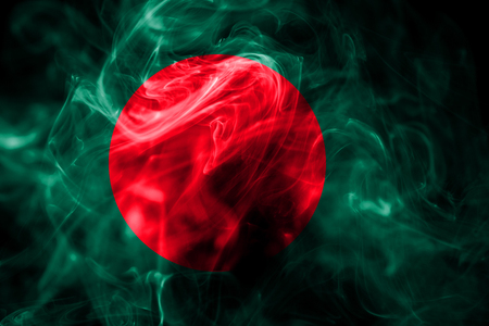 National flag of Bangladesh made from colored smoke isolated on black background. Abstract silky wave background. Stockfoto