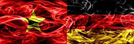 Socialist Republic of Viet Nam vs Germany, German smoke flags placed side by side. Thick colored silky smoke flags of Vietnam and Germany, German