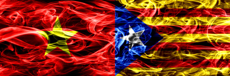 Socialist Republic of Viet Nam vs Catalonia, Spain smoke flags placed side by side. Thick colored silky smoke flags of Vietnam and Catalonia, Spain