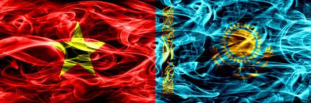 Socialist Republic of Viet Nam vs Kazakhstan, Kazakhstani smoke flags placed side by side. Thick colored silky smoke flags of Vietnam and Kazakhstan, Kazakhstani 版權商用圖片