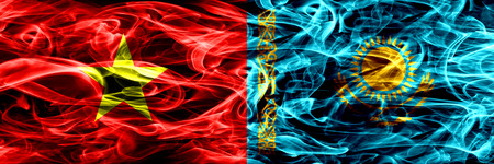 Socialist Republic of Viet Nam vs Kazakhstan, Kazakhstani smoke flags placed side by side. Thick colored silky smoke flags of Vietnam and Kazakhstan, Kazakhstani Archivio Fotografico