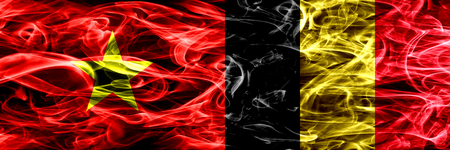 Socialist Republic of Viet Nam vs Belgium, Belgian smoke flags placed side by side. Thick colored silky smoke flags of Vietnam and Belgium, Belgian Stock Photo