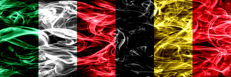 Italy vs Belgium, Belgian smoke flags placed side by side. Thick abstract colored silky smoke flags Stock Photo