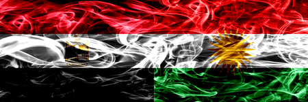 Egypt, Egyptian vs Kurdistan, Kurdish smoke flags placed side by side. Thick abstract colored silky smoke flags