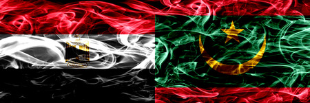 Egypt, Egyptian vs Mauritania, Mauritanian smoke flags placed side by side. Thick abstract colored silky smoke flags
