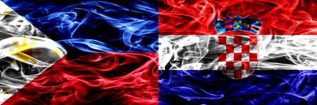 Philippines vs Croatia, Croatian smoke flags placed side by side. Thick abstract colored silky smoke flags Фото со стока